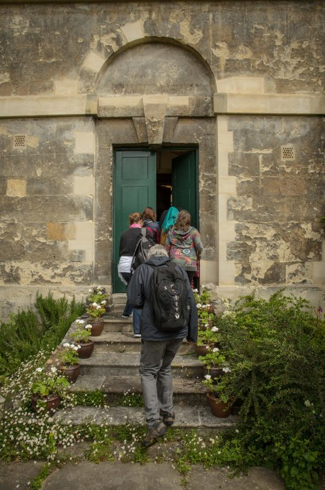 Michael Rosen enters the 'Alice Door', Christ Church Oxford
