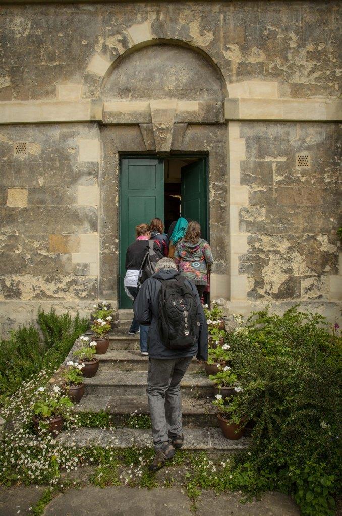 Michael Rosen enters the 'Alice Door', Christ Church Oxford