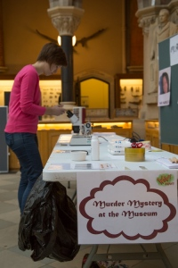 Sally Le Page sets up the forensic science experiments on the Murder Mystery at the Museum stall