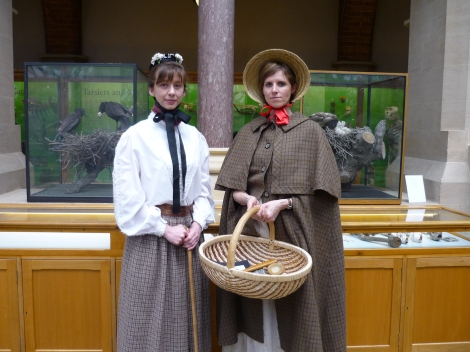 Mary Kingsley (l) and Mary Anning (r) prepare for their appearance in Soapbox City