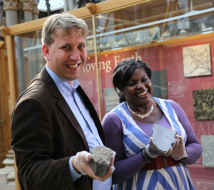 Chris holds a piece of the Chandakapur, Maggie holds a slice of the Gibeon meteorite
