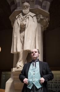 Joe Kenneway as Charles Darwin, beside Charles Darwin