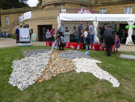 Festival-goers constructing a geological map of Yorkshire using stones. Smith would have been proud!