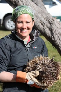 Me, taking a break from fossil hunting to cuddle an echidna.