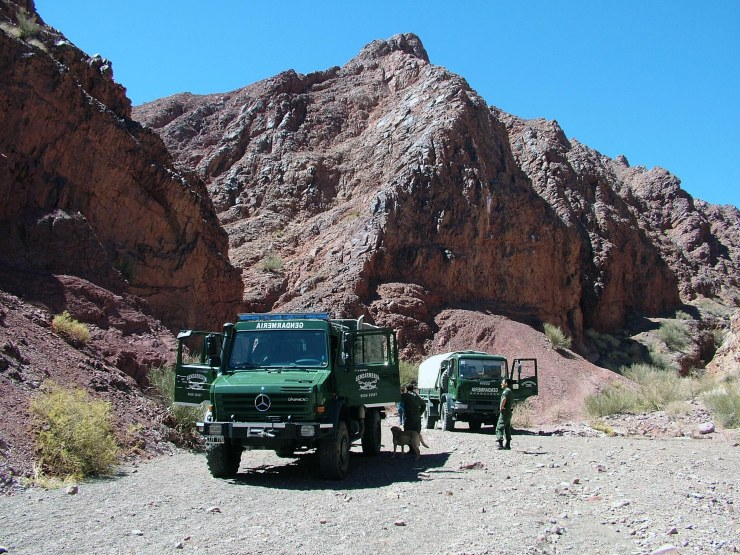 The army vehicles arranged for transporting the field trip participants to the rugged terrain of the Argentine Precordillera