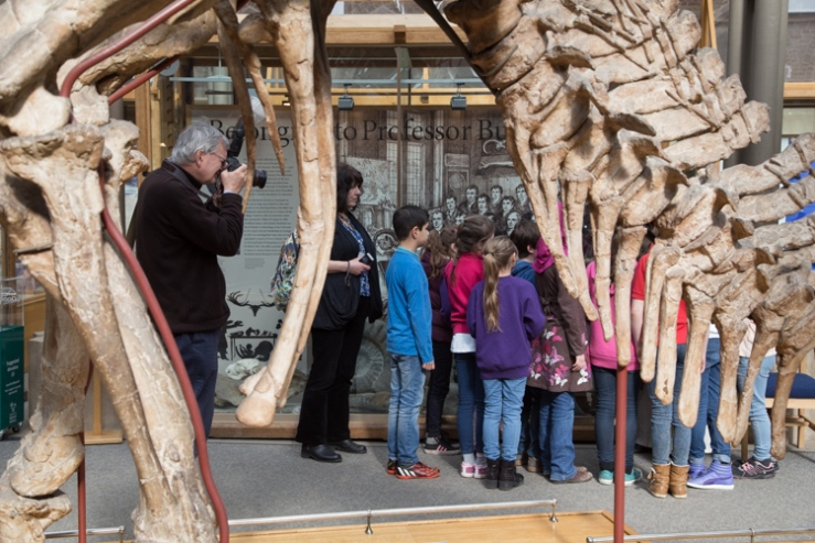 Martin Parr, an Iguanodon and young visitors