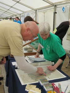 Monica and a festival-goer discuss William Smith's map