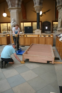 Returning the Edmontosaurus base to the museum court with supervisor Pete Johnson