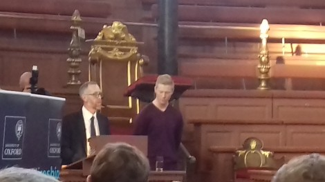 Adam collecting his award at the Sheldonian Theatre in Oxford